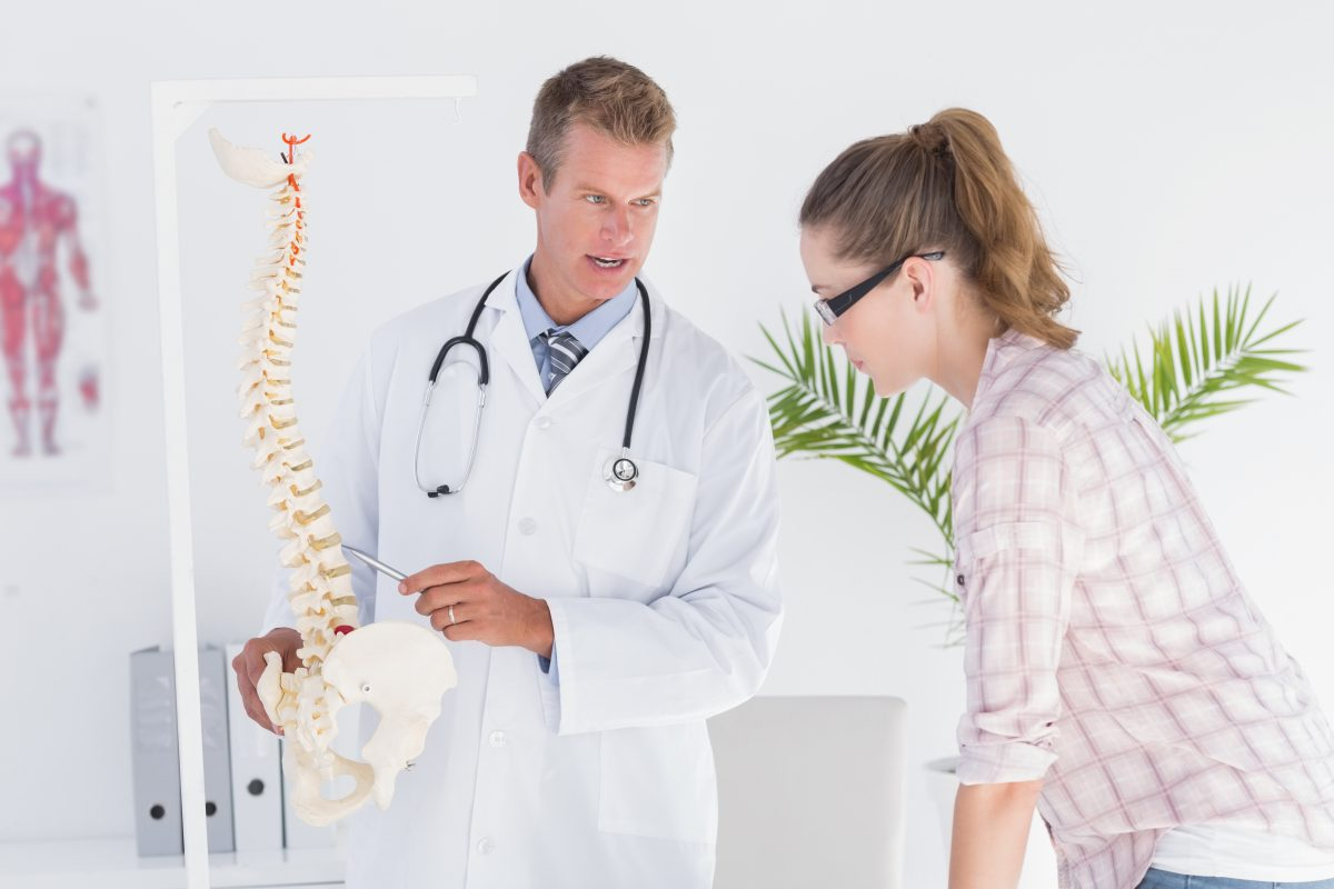 Physician explaining the spine